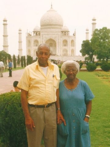 Grandpa and Grandma the explorers in India with the Taj behind him